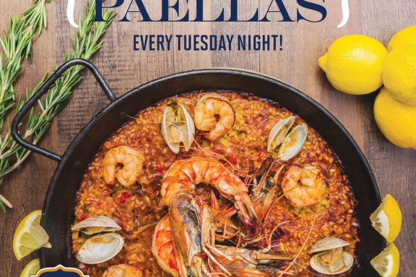 photo of a traditional spanish paella. paella is a rice dish with clams, shrimp and chicken.